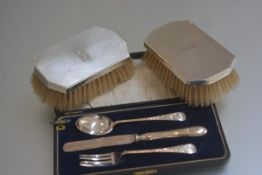 An Edwardian Birmingham silver three piece Christening set comprising a fork, spoon and knife and