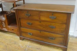 An Edwardian walnut chest, the rectangular top with moulded edge above two short and two long