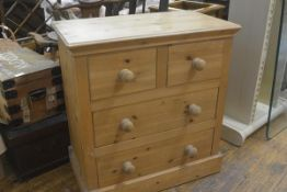 A modern pitch pine chest, the rectangular top with moulded edge above two short and two long