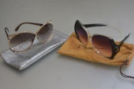 A pair of Christian Dior vintage gilt and acetate sunglasses and a pair of Yves Saint Laurent tinted