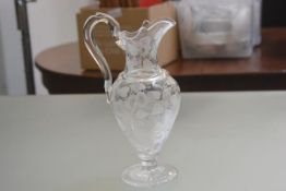 A 19thc baluster water jug with allover engraved clematis leaf and flower decoration (stress mark to