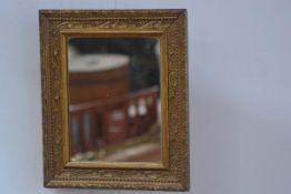 A 19thc gilt composition rectangular framed wall mirror (35cm x 30cm)