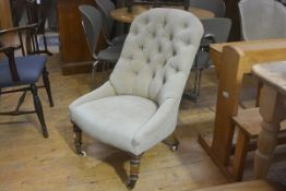 A Victorian nursing chair with upholstered button back and side supports and seat, in fawn plush,