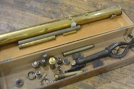 A Clarksons Optical Stores Holburn, London, brass telescope with eight various optical lenses,
