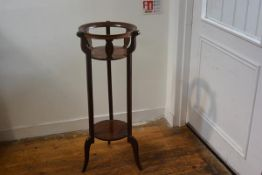 An Edwardian mahogany satinwood and boxwood strung inlaid two tier jardiniere stand, the circular