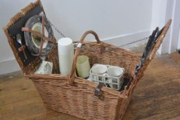 A wicker picnic hamper by Brexton, c.1960 complete with teak handled knives, plates, cups, mugs