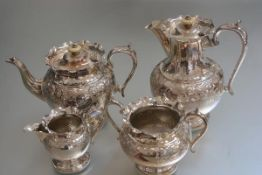 An Edwardian four piece Epns tea and coffee service with chased floral decoration (coffee pot: