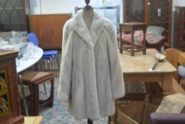 A lady's Emba American mink Tourmaline natural pale beige mink jacket, with short collar and two