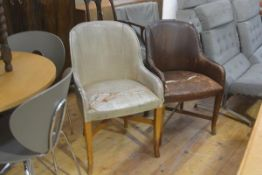 A pair of 1930s leather upholstered tub chairs on oak square tapered splay supports united by X