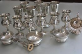 A set of six pewter wine goblets, a set of six baluster pewter goblets, three various pewter