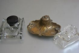A French style brass desk inkstand with hinged top enclosing an original ceramic liner, with olive