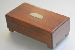 A mahogany musical cigarette box, the rectangular hinged top with presenation plaque, D Ferguson