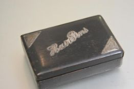 An ebonised rectangular hairpin box with London silver mounted engraved corners and hairpin panel,