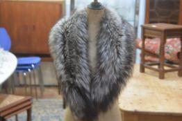A grey fox fur collar with satin lining (96cm x 15cm)
