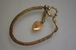 A Victorian gilt metal guard chain with swivel and plated paste set heart (18.5cm)