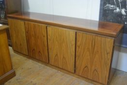 A Skouby Danish rosewood sideboard c.1975/80, the rectangular moulded top above four panel doors,