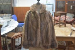 A lady's ranch mink short jacket with V collar and slash pockets to side, with satin lining and