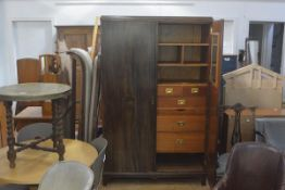 A 1930s figured and inlaid walnut two door wardrobe with moulded cornice, with fully fitted
