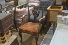 A 19thc mahogany pierced back carver chair with plush upholstered seat, raised on carved moulded