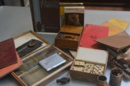 A mixed lot containing a treen carved box with pencils, a white metal cigarette case, a box with