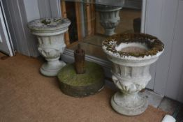 A pair of composition stone urns with fluted and scrolling bowls, raised on circular bases (h.52cm