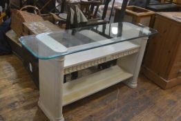 A light ash finish console table with rectangular plate glass top above two open shelves, raised