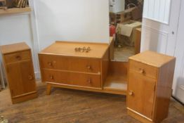 A Meredew 1950s Utility three piece bedroom suite comprising a pair of bedsides fitted single drawer