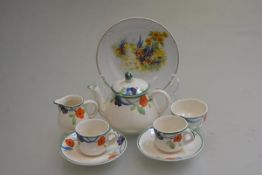 An ivory ware handpainted doll's seven piece teaset and an English china painted plate (a lot) (