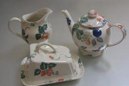 A Royal Winton Strawberry pattern spongeware decorated part breakfast set including milk jug, teapot