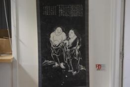 A Japanese scroll depicting two Monks with characters above and seal mark to base with silk