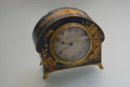 A 1920s French mantel clock with chinoiserie blue ground decorated arched case, with silvered dial