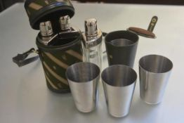 A case containing a three section glass Epns mounted set of flasks with matching set of four