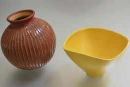 Roger Carbo, a circular incised pottery vase with terracotta glaze and a yellow Studio Pottery