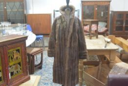 A 1930s musquash flapper style coat with stand up collar and satin lining, with slash pockets to