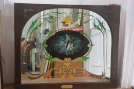 A mahogany framed arched pub mirror with reverse painted panel, depicting an Angel Fish,