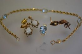 A 9ct gold rope pattern chain set three oval aquamarines, 10ct gold mounted aquamarine mounted