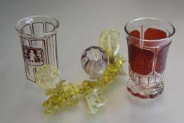A Bohemian ruby flash glass engraved octagonal cylinder vase, a ruby flash glass slice cut vase