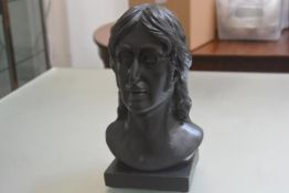 A plaster cast black painted bust of John Lennon (h.35cm x 20cm x 19cm)