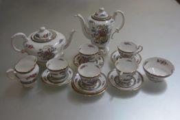 A Paragon Tree of Kashmir coffee service comprising five cups, six saucers, milk jug, sugar basin,