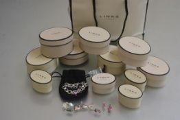 A Links of London silver oval link charm bracelet with wellington boot and eight various other