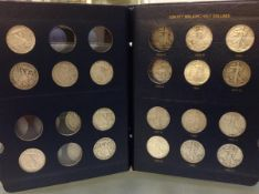A group of 35 U.S. Liberty Walking half dollars condition G to EF, varying dates or mint marks, in a