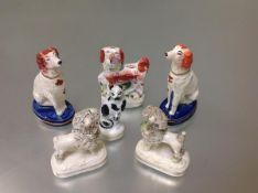 A group of 19th century Staffordshire dog and cat models comprising: a pair of seated spaniels, each