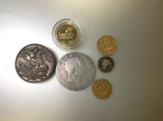 A group of GB coins comprising: a Victorian half sovereign 1898; an Edwardian half sovereign 1907; a