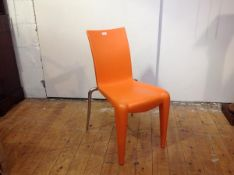 A Louis 20 chair by Philippe Starck for Vitra, in orange, with paper label.