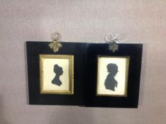 """Two 19th century silhouette portraits of ladies, one inscribed verso """"Mary Compton / aged 14/ 1822"""","""