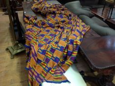 Ghana: a Kente cloth, polychrome woven strips, in dyed silk and cotton. 200cm by 300cm