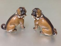 A pair of late 19th century porcelain models of seated pugs, possibly Conta & Boehme, after