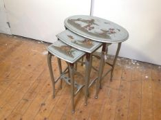 A set of three 1920's silver lacquer Chinoiserie nesting tables, probably Hille of London, oval,