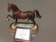 A Royal Worcester porcelain limited edition model of a Hackney Stallion, by Doris Lindner, mounted