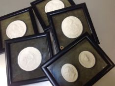 A set of six framed plaster intaglios, of Renaissance and Classical subjects, oval and circular,